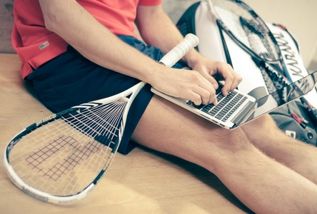 Squash player on laptop