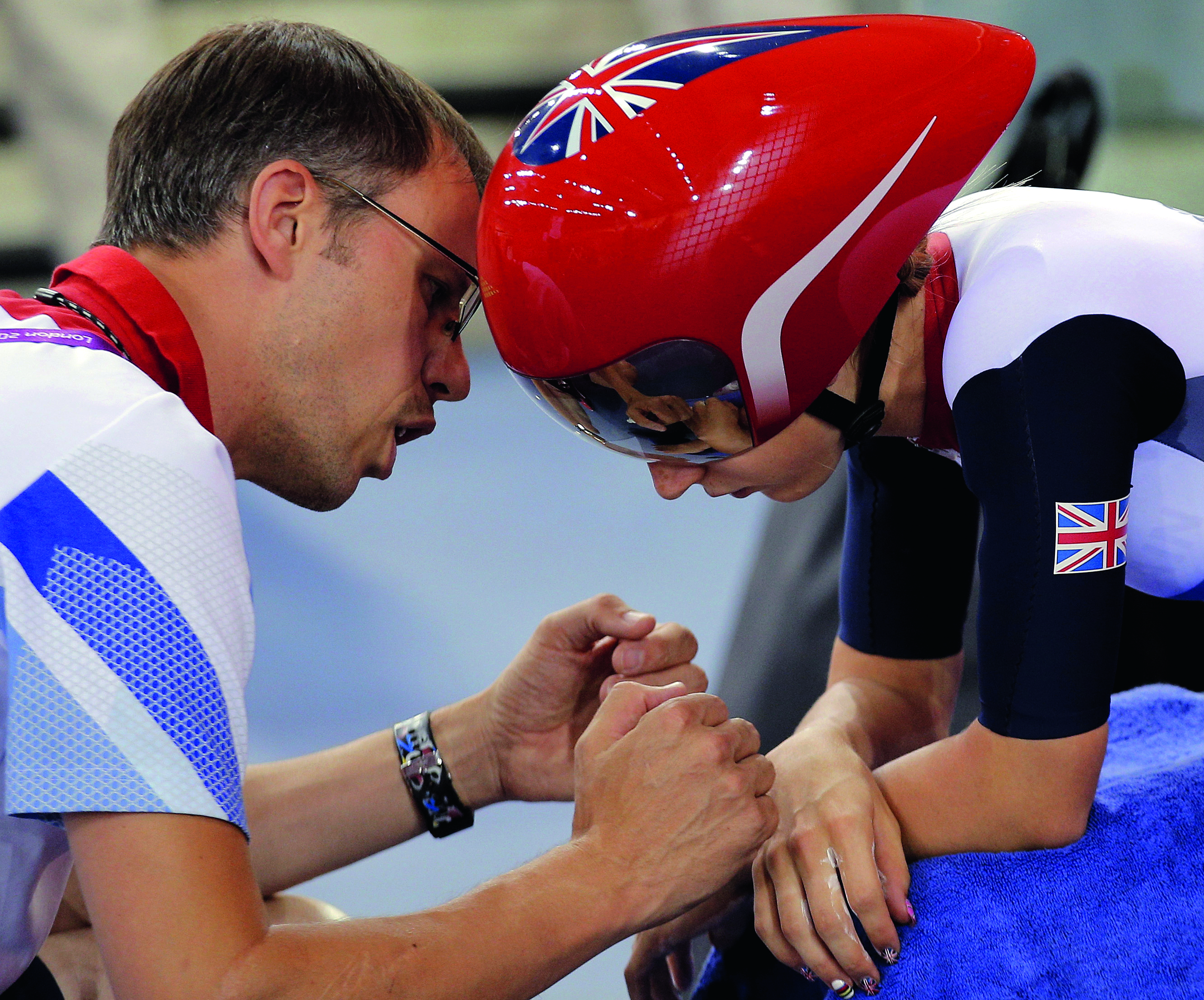 Laura Trott and coach Paul Manning in 2012